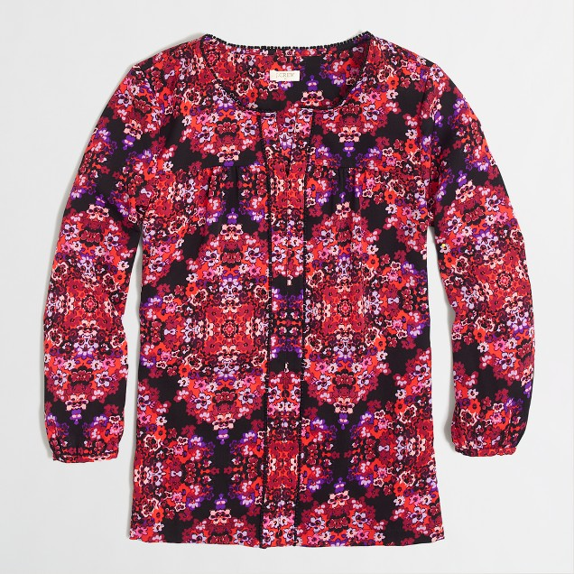 Factory printed peasant top with mini pom-pom trim