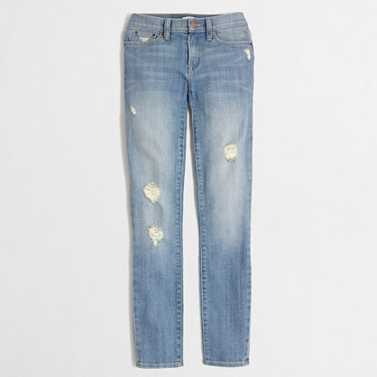 Skinny jean in distressed wash
