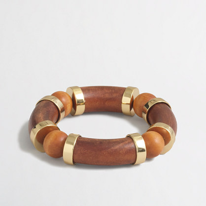 Wooden bracelet with golden accents