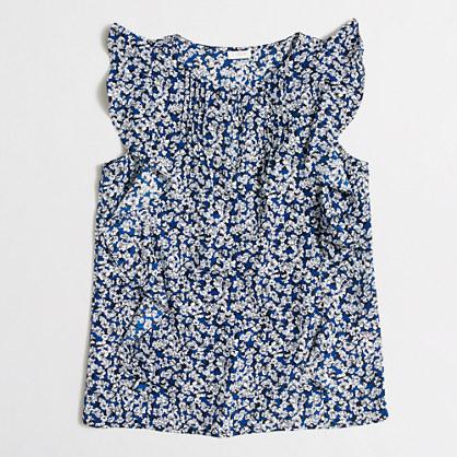Sleeveless printed cascade ruffle blouse
