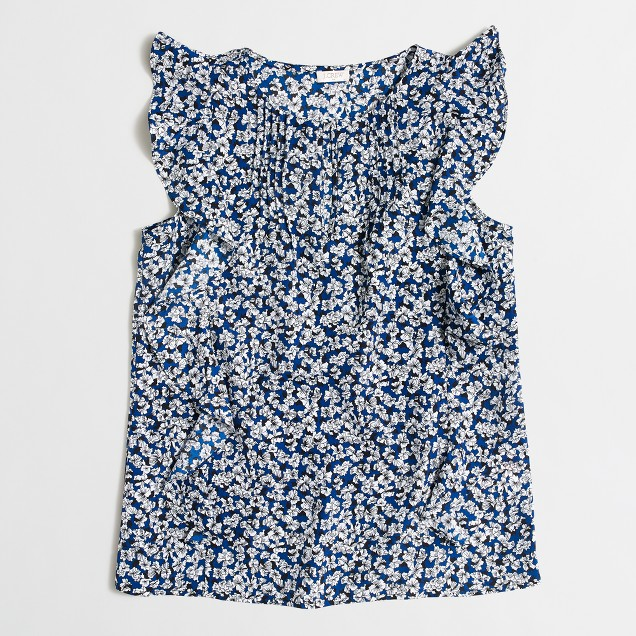 Sleeveless printed cascade ruffle blouse