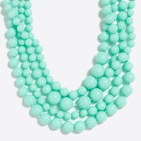 Multi-strand beaded necklace with critter clasp