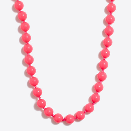 Single-strand beaded necklace with ladybug clasp