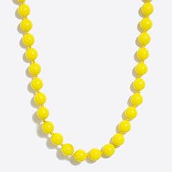Single-strand beaded necklace with ladybug clasp